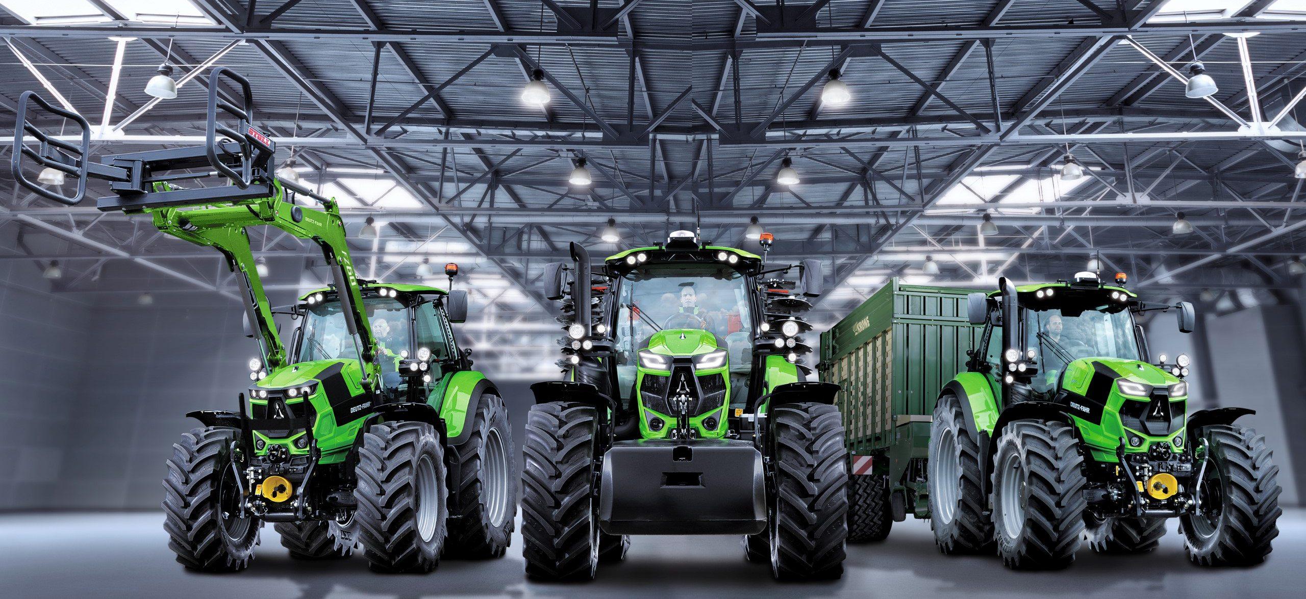 Drei verschiedene Ausführungen der Agrotron Serie 6 Traktoren in einer Halle